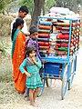 Vendor with Clients - Outside Lumbini - Terai - Nepal (13845484883).jpg