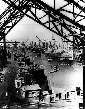 USS Betelgeuse (AK-260) - SS Colombia Victory, fourth ship, Hull No. MCV-10 and other Victory cargo ships are lined up at a U.S. west coast shipyard