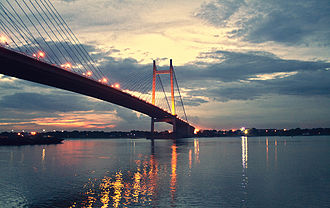 Toll bridge - The bridge Vidyasagar Setu illuminated at night in Kolkata (India).