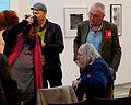 Vienna 2013-03-13 'Salon für Kunstbuch' - Ilse Kilic talking to Rolf Schwendtner, in BG (r) Gerhard Jaschke.jpg
