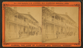 View of people in their balconies in a residential street, from Robert N. Dennis collection of stereoscopic views.png