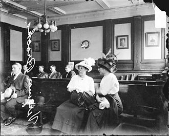 Calumet City, Illinois - A 1903 portrait of Virginia Brooks, an unidentified woman and men sitting in a room, probably in a courthouse or police station. The women are probably associated with vice in Calumet City