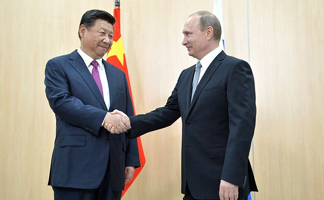 From commons.wikimedia.org: Vladimir Putin and Xi Jinping {MID-140156}
