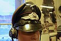 WW2 German Luftwaffe visor cap. NCO candidate for communication (golden brown Waffenfarbe for signal troops) Lofoten Krigsminnemuseum 2019-05-08.jpg