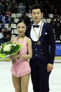 Wang Xuehan and Wang Lei at the 2014 Trophée Éric Bompard - Awarding ceremony.jpg