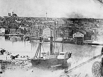 Port of Baltimore - A steamship docked in Federal Hill in 1849 with the Basilica and the Washington monument in the distance.