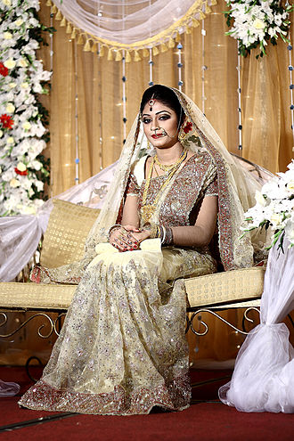 Physical attractiveness - Bengali Bride exemplifying wedding day beauty