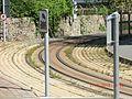 Welsh Highland Railway Track through Porthmadog - panoramio.jpg