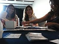 Wikimania 2015-Tuesday-Volunteers organise the attendee badges.jpg