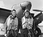 Wing Commander R W Reynolds (right), CO of No. 139 Squadron RAF, with his navigator, Flight Lieutenant E B Sismore, and a de Havilland Mosquito Mk IV at Marham, Norfolk, 1943. CH10135.jpg