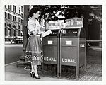 Woman Mailing a Letter (2550242671).jpg