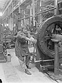 Woman operating rifling machine Royal Gun Factory 1918 IWM Q 27839.jpg