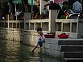 Women washing clothes in a canal, Zhouzhuang Jiangsu China.jpg