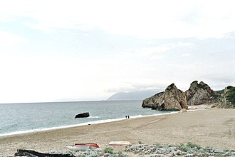 Xinovrysi - Potistika beach. In the middle of the photo the Skamni rock, and at background the mountains of Skiathos island.