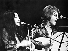 Yoko Ono and John Lennon performing