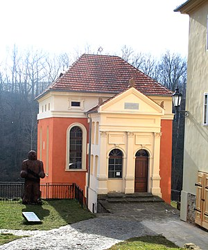 Practical Kabbalah - Úštěk Synagogue with statue of Prague Golem at Úštěk in the Czech Republic