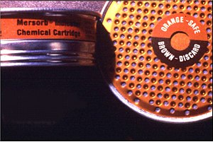 Cartridges and canisters of air-purifying respirators - End of Service Life Indicator (ESLI). The saturation of the sorbent mercury vapor leads to the change of the color (circle in the center) from orange to brown