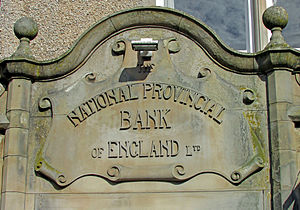 National Provincial Bank - Original carved headstone surviving at the Holyhead branch in Anglesey.