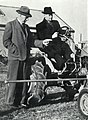 1950 E R Hudson discusses points of a tractor.jpg