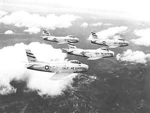 Van Nuys Air National Guard Base - 195th FIS 4-ship F-86H about 1958. North American F-86H-10-NH Sabre 53-1382 in foreground 53-1505 also identifiable