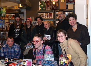 Jennifer Camper - Camper, at right with other LGBT comics creators at a February 28, 2014 signing at Jim Hanley's Universe in Manhattan for the LGBT anthology Qu33r.