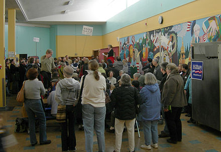 A 2008 Washington state Democratic caucus held in the school lunchroom of Eckstein Middle School in Seattle. In some states like Washington, voters attend local meetings run by the parties instead of polling places to cast their selections. 2008 Wash State Democratic Caucus 17B.jpg