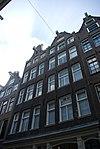 foto van Groep van twee huizen die samen een blok etagewoningen vormen
