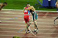 251000 - Athletics track pentathlon Don Elgin exhausted - 3b - 2000 Sydney race photo.jpg