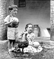 3 year old Ellwood Towle and 6 year old Rolfe Towle holding ostrich eggs near a young ostrich- Saint Augustine, Florida (3309472408).jpg