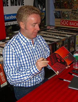Superman: Red Son - Writer Mark Millar signing a copy of the collected edition during an appearance at Midtown Comics in Manhattan
