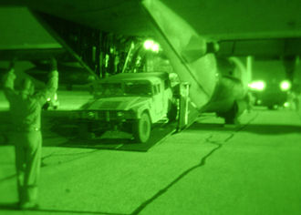 Duke Field - 711th Special Operations Squadron loadmaster, performs static load training with a special operations team for rapid infiltration