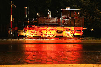 Ingolstadt Hauptbahnhof - Plinthed locomotive 98 507 in front of the station
