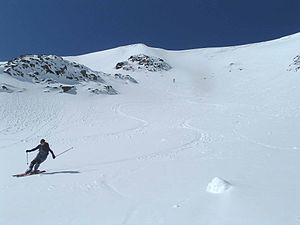 Aonach Mòr - A skier on Summit Gully, one of many off piste runs on Aonach Mor