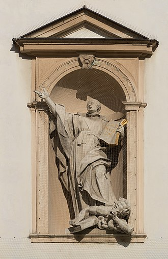 A statue in Vienna portraying Saint Ignatius of Loyola trampling on a heretic AT-119587 Fassadendetails der Jesuitenkirche in Wien -hu- 8947.jpg