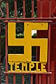 A Swastika at the temple entrance gate, India.jpg