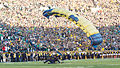 A U.S. Sailor with the Leap Frogs parachutes onto the field at Notre Dame Stadium in South Bend, Ind., Sept. 6, 2014, before a football game 140906-D-KC128-143.jpg