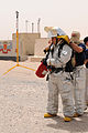 A contracted firefighter dons his gear during a simulated chemical incident May 25, 2010, at Camp Buehring, Kuwait 100525-A-EG775-017.jpg