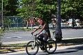 A man in a mask and in a bike.jpg