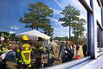 A reflection of first responders on a bus window during a mass casualty exercise during the Vigilant Guard South Carolina exercise.jpg