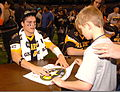 A young boy gets the autograph of a football player at the U.S. Army All American Bowl, in the Alamodome in San Antonio, Tex., Jan. 7, 2012 120107-A-UD635-966.jpg