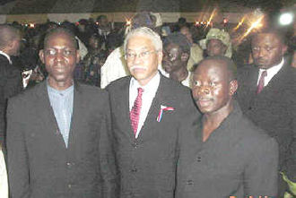 Adams Oshiomhole - Adams Oshiomhole, former President of the Nigeria Labour Congress (right) with U.S. Ambassador to Nigeria Howard F. Jeter (center), 5 July 2002, Lagos.