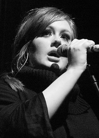 """Thank U, Next"" was the first song by a female artist to debut at number one on the Billboard Hot 100 since ""Hello"" by Adele (pictured) in 2015. Adele - Live 2009 (4) cropped.jpg"