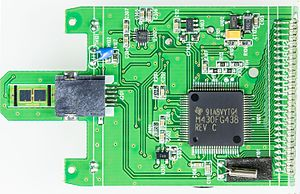 TI MSP430 -  Aktivmed GlucoCheck Comfort glucose meter- Printed circuit board below the LCD hosting an MSP 430 CPU