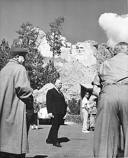 Hitchcock at Mount Rushmore filming North by Northwest (1959) Alfred Hitchcock on the set of North By Northwest.jpg