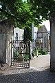 Alte Grieser Pfarrkirche - Eingang an der Westseite zum Friedhof.JPG