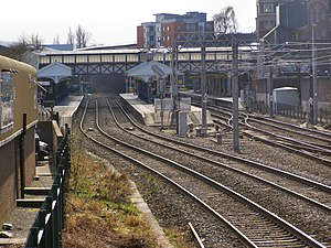 Altrincham Interchange - Altrincham Interchange; the railway platforms to the left, and the tram platforms to the right.