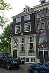 foto van Hoekhuis onder omlopend schilddak en -daklijst
