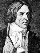 Black and white print shows a clean-shaven man with hair reaching almost to his shoulders. He wears a civilian coat open at the front with a white shirt and white scarf around his neck.
