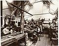Arbeiders aan een werkbank in een fabriek, RP-F-F03787.jpg
