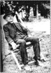 Black and white photograph of Arthur Corlette seated.